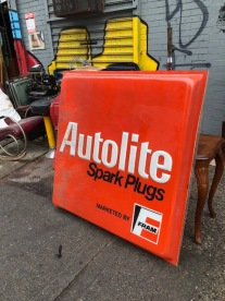 AUTO LITE ORANGE SIGN