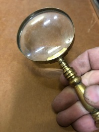BRASS MAGNIFYING GLASS $50